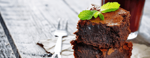 a gooey chocolate brownie pictured with a fork